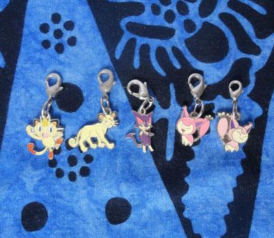 Pokemon Meowth, Persian, Purrloin, and Skitty Pokemon Center Charms