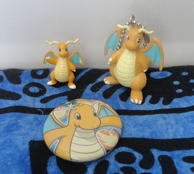 Pokemon Dragonite Figures and Can Badge