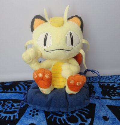 Pokemon Osaka Meowth Plush on Blue Cushion